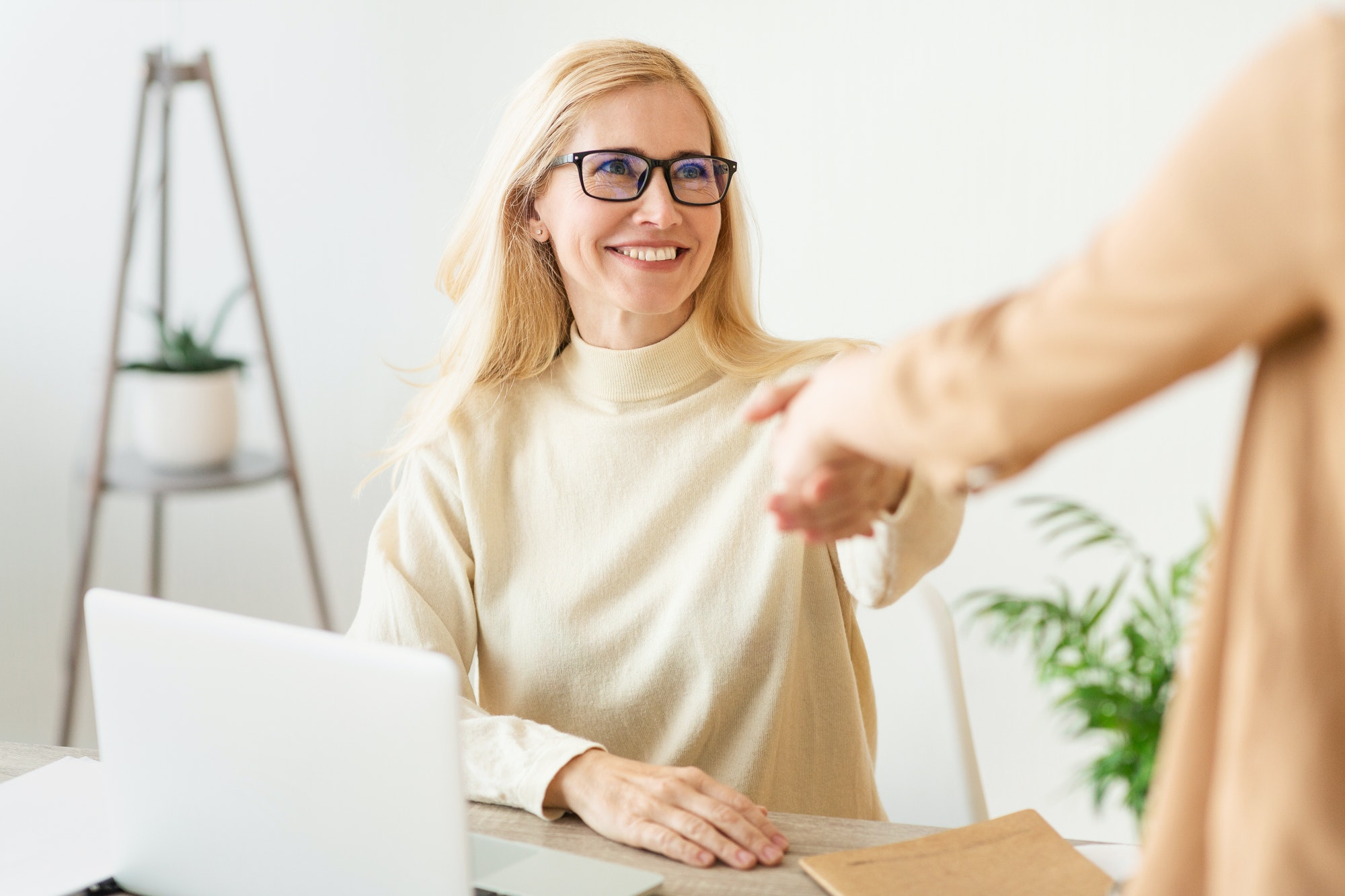 Confident woman job seeker applicant handshaking hr